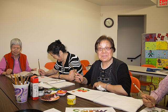 Seniors participating in the Pui Hong Chinese program gather to learn and create beautiful traditional Chinese paintings.