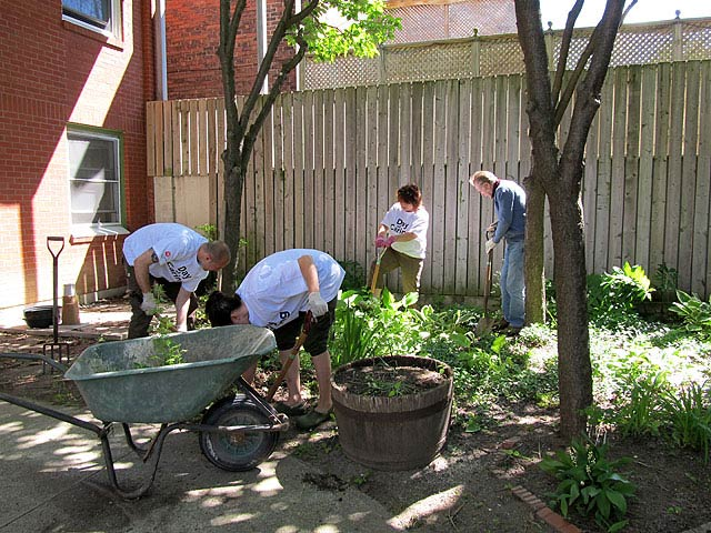 United Way Days of Caring volunteers garden with seniors at Jean Dudley House.