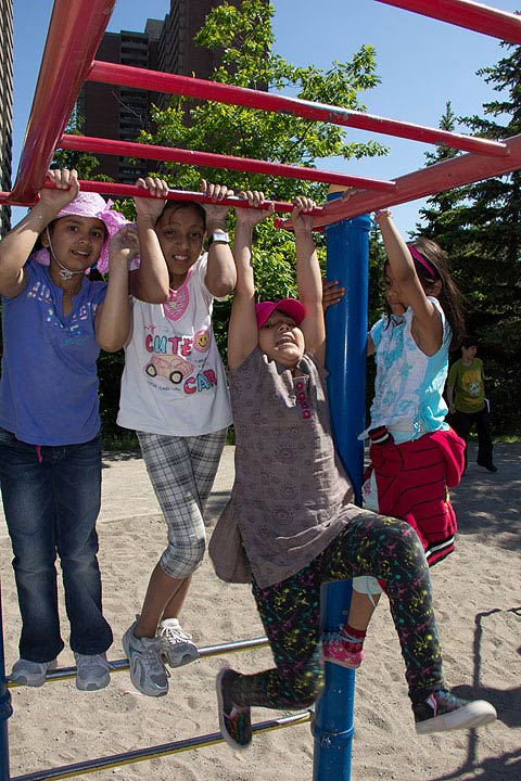 Children in the Kick Start program get into the swing of things and stay active at a local park.